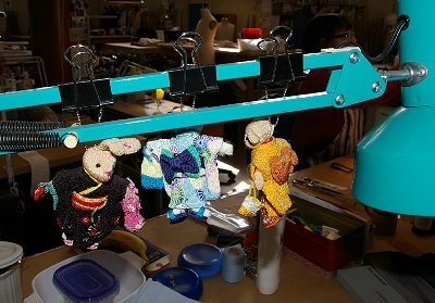 Doll decorations at a seamstress workstation at Seattle Opera.