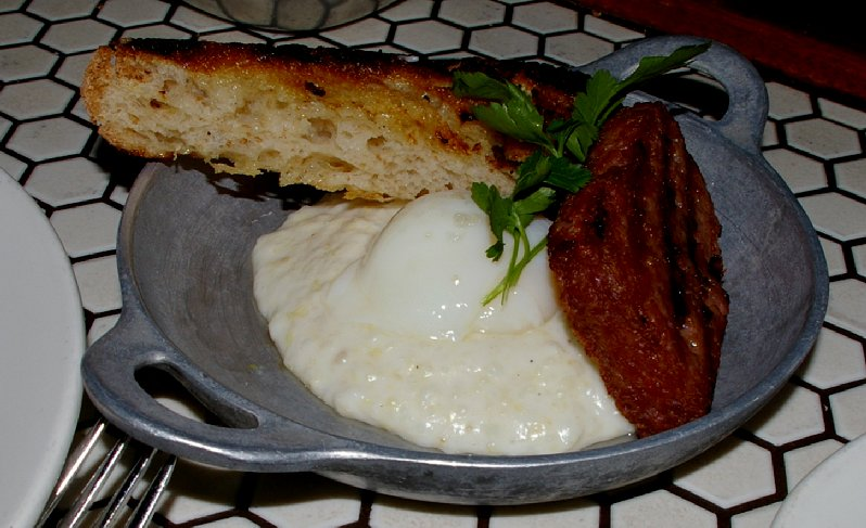 The Palace Kitchen's Berkshire Spam served with poached egg and grits.