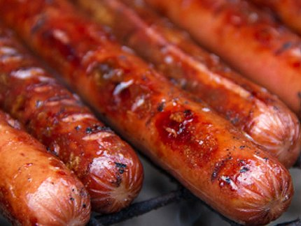 Hot dogs grilling at Oakbrook Golf Course in Lakewood, Washington - image.