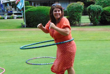 Hula hooping at the Tacoma Executives Association Golf Tournament in Tacoma, Washington - image.