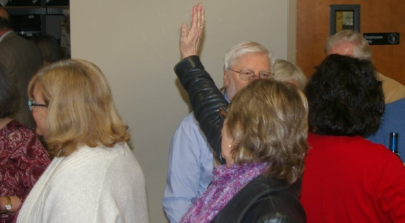 Sue Lord waves to friends across the room at Ted Brown Music in Tacoma - image.