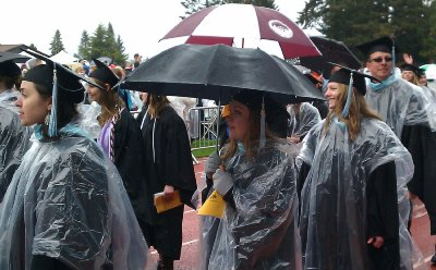 UPS students walking into Baker Stadium in their rain gear.